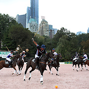 Action during the Central Park Arena Polo Challenge held in the Wollman Ice Rink in Central Park showing a City backdrop. The event was the first ever polo match played in Central Park and was part of the four day Central Park Horse Show. Central Park, Manhattan, New York, USA. 21st September 2014. Photo Tim Clayton