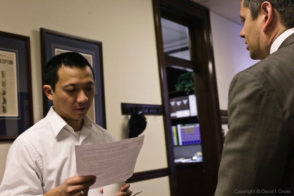 Democratic representatives Scott Kawasaki (left) and Chris Tuck (right) chat outside their offices in the Alaska State Legislature.