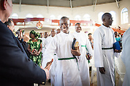 Pastoral candidates greet guests as they process into a service with more than 1,000 worshippers on Sunday, March 15, 2015, at the Evangelical Lutheran Church in Tanzania – South-East of Lake Victoria Diocese's (ELCT-SELVD) Ebenezer Cathedral in Shinyanga, Tanzania. LCMS Communications/Erik M. Lunsford