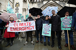 © Licensed to London News Pictures. 27/02/2020. London, UK. Protesters who oppose the expansion of Heathrow Airport gather outside the High Court. Judges will deliver their ruling on a number of appeals against the planned construction of a third runway at the London airport. Photo credit: Rob Pinney/LNP
