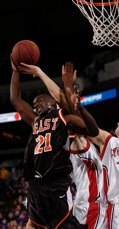 2/11/06 -- Omaha, Ne.Sioux City East's Roman Gentry fights for a rebound at The Omaha Shootout, a High School Basketball tournament featuring some of the best prospects at the Qwest Center Omaha...(Photo by Chris Machian/Prarie Pixel Group).