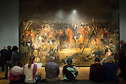 Visitors viewing Jan Willem Pieneman 'The Battle of Waterloo' oil on canvas painting at Rijksmuseum, Amsterdam, Holland