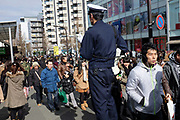 Police controlling crowds of shoppers, Tokyo, japan