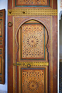 Berber Arabesque painted wood door .The Petite Court, Bahia Palace, Marrakesh, Morroco .<br /> <br /> Visit our MOROCCO HISTORIC PLAXES PHOTO COLLECTIONS for more   photos  to download or buy as prints https://funkystock.photoshelter.com/gallery-collection/Morocco-Pictures-Photos-and-Images/C0000ds6t1_cvhPo<br /> .<br /> <br /> Visit our ISLAMIC HISTORICAL PLACES PHOTO COLLECTIONS for more photos to download or buy as wall art prints https://funkystock.photoshelter.com/gallery-collection/Islam-Islamic-Historic-Places-Architecture-Pictures-Images-of/C0000n7SGOHt9XWI