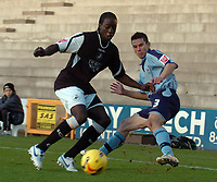 Photo: Paul Greenwood.<br />Port Vale v Swansea City. Coca Cola League 1. 18/11/2006. Swansea's Kevin Amankwaah muscles Vale's Jason Talbot off the ball