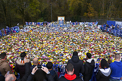 Fans view floral tributes for those who lost their lives in the Leicester City helicopter crach including Leicester City Chairman Vichai Srivaddhanaprabha ahead of the Premier League match at the King Power Stadium, Leicester.