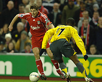 Photo: Paul Greenwood.<br />Liverpool v Arsenal. The FA Cup. 06/01/2007. Liverpool's Steven Gerrard drives past Arsenal's Justin Hoyt