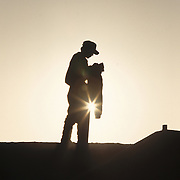 A undocumented migrant just inside the US/Mexico border on the Tijuana Levy, waits for sundown before making a run for the US. Please contact Todd Bigelow directly with your licensing requests. PLEASE CONTACT TODD BIGELOW DIRECTLY WITH YOUR LICENSING REQUEST. THANK YOU!