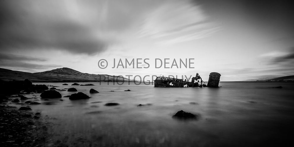 A long exposure of the wreck Wyre Majestic in The Sound of Islay. It is sited near Bunnahabhain and the distant hill is Sgarbh Breac