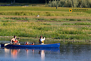 Family canoeing on Upper Stillwater Lake in Montana model released