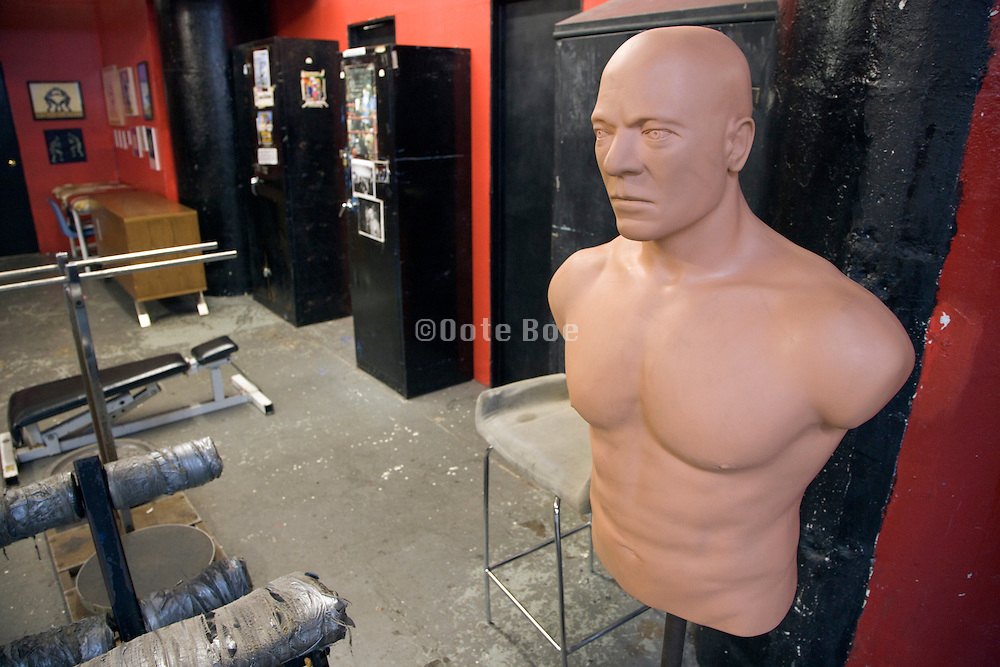 a muscular boxing punch dummy in a boxing school training facility