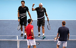 Lukasz Kubot and Marcelo Melo (top) celebrate after the Doubles match during day six of the Nitto ATP Finals at The O2 Arena, London.