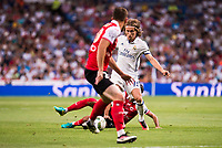 Real Madrid's player Luka Modric and Stade de Reims's player Bouhours and Berthier during the XXXVII Santiago Bernabeu Trophy in Madrid. August 16, Spain. 2016. (ALTERPHOTOS/BorjaB.Hojas)