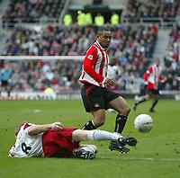 Photo. Andrew Unwin.<br /> Sunderland v Sheffield United, FA Cup Sixth Round, Stadium of Light, Sunderland 07/03/2004.<br /> Sheffield United's Stuart McCall (l) puts in a sliding challenge on Sunderland's Jeff Whitley (r).