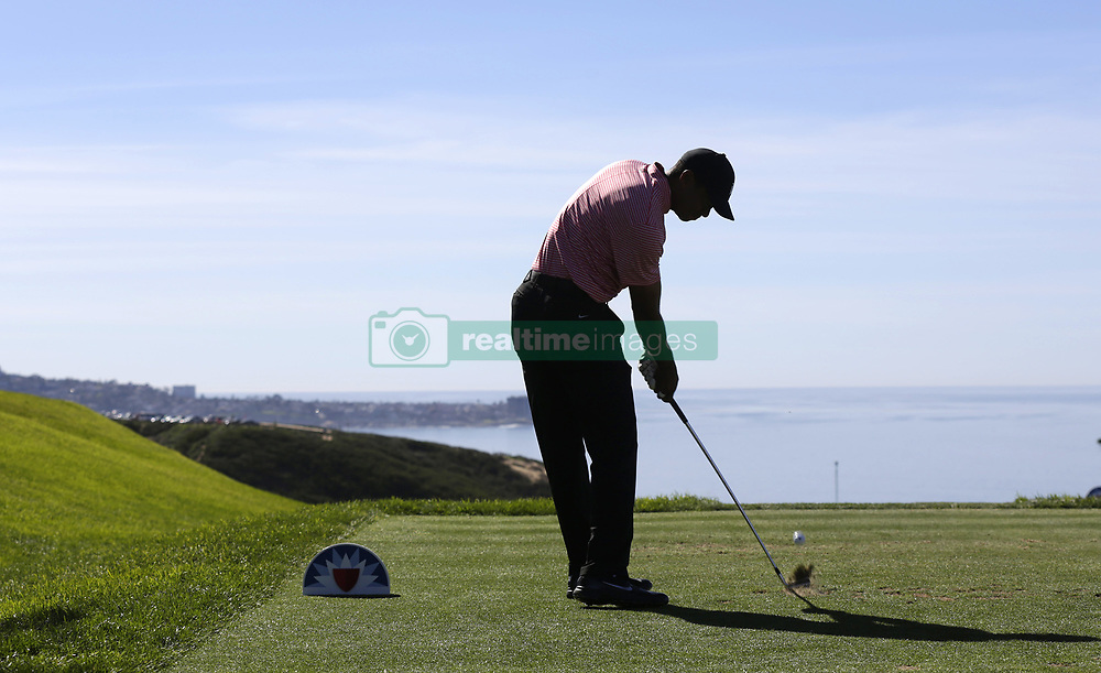 January 27, 2019 - San Diego, CA, USA - Tiger Woods tees off on the 3rd hole during the fourth round of the Farmers Insurance Open at the Torrey Pines Golf Course in San Diego on Sunday, Jan. 27, 2019. (Credit Image: © K.C. Alfred/San Diego Union-Tribune/TNS via ZUMA Wire)