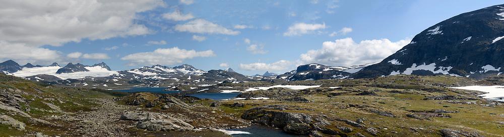Sognefjellet with Smörstabbtindan (mountain ridge 2077 - 2222 m elevation) and Smörstabbreen (the largest glacier in Jotunheimen) in the background.