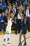 Golden State Warriors forward Andre Iguodala (9) looks for an open teammate against the Utah Jazz at Oracle Arena in Oakland, Calif., on December 27, 2017. (Stan Olszewski/Special to S.F. Examiner)