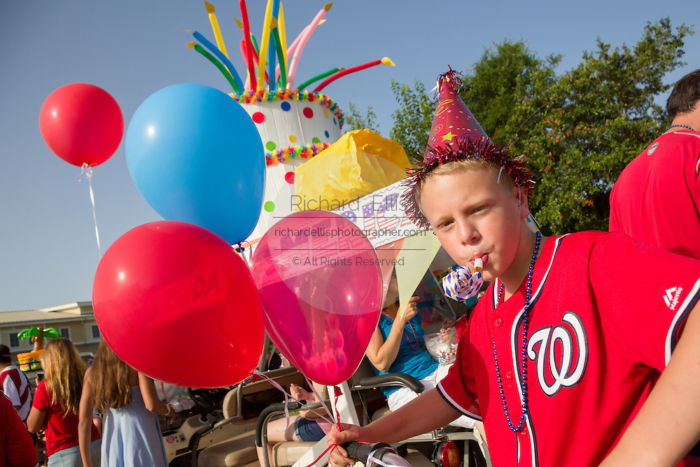 A young boy dressed for a birthday party as America celebrates Independence Day with a golf cart parade July 4, 2015 in Sullivan's Island, South Carolina.