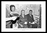 Picture shows President Kennedy sitting beside the fireside inside his ancestral homestead having a cup of tea.  On the left is Miss Josephine Ryan, daughter of Mrs. Ryan.<br /> <br /> 27th June 1963