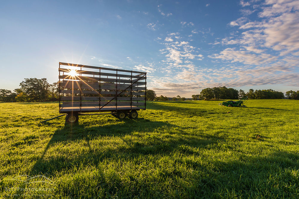 A hay wagon in a field at the Woodward Point Preserve in Brunswick, Maine.