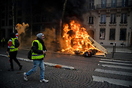 Many cars and scooters were burned during the protest. More than 125000 gathered in Paris for the Gilets Jaune (Yellow vest) protest. Soon the protest turned violent an protesters clashed with the police, tear gas and flash bombs were fired, many injured and arrested by the police. Paris December 6th 2018. Federico Scoppa