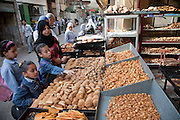 A woman and children shop for bread at a local bakery in Cairo.