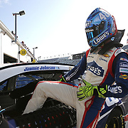 Sprint Cup Series driver Jimmie Johnson (48) climbs from his car during the 57th Annual NASCAR Coke Zero 400 practice session at Daytona International Speedway on Friday, July 3, 2015 in Daytona Beach, Florida.  (AP Photo/Alex Menendez)