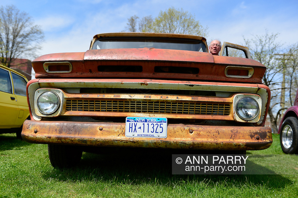Seen from the rear, this red and white 1964 Chevrolet C-10 pickup, with an 8-Foot bed, is at the Antique Auto Show, where New York Antique Auto Club members exhibited their cars on the farmhouse grounds of Queens County Farm Museum. The truck, now rusted, has been in the family of Paul and Janet Gramlich since it was new.