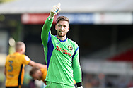 Newport county goalkeeper Joe Day celebrates at the end of the game, having a clean sheet and keepng score 0-0.   EFL Skybet football league two match, Newport county v Wycombe Wanderers at Rodney Parade in Newport, South Wales on Saturday 9th September 2017.<br /> pic by Andrew Orchard, Andrew Orchard sports photography.