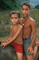 Two young boys riding a horse bareback near to Vinales; Pinar Province; Cuba,