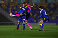 AFC Wimbledon striker Joe Pigott (39) battles for possession with Peterborough United defender Mark Beevers (5) during the EFL Sky Bet League 1 match between AFC Wimbledon and Peterborough United at Plough Lane, London, United Kingdom on 2 December 2020.