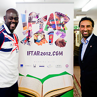 London, UK - 21 July 2012: Team GB Olympic discus thrower Abdul Buhari poses for a picture with Shaukat Warraich, CEO and Founder of Faith Associates, during the Ramadan Iftar 2012 celebrations hosted at the Islamic Cultural Centre (ICC) in Regents Park.