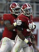 TUSCALOOSA, AL - NOVEMBER 10:  Linebacker C.J. Mosley #32 (right) of the Alabama Crimson Tide celebrates with teammate and defensive lineman Quinton Dial #90 during the game against the Texas A&M Aggies at Bryant-Denny Stadium on November 10, 2012 in Tuscaloosa, Alabama.  (Photo by Mike Zarrilli/Getty Images)