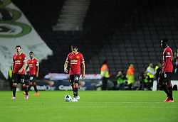 Manchester United players cut dejected figures after conceding the first goal of the game - Photo mandatory by-line: Joe Meredith/JMP - Mobile: 07966 386802 26/08/2014 - SPORT - FOOTBALL - Milton Keynes - Stadium MK - Milton Keynes Dons v Manchester United - Capital One Cup