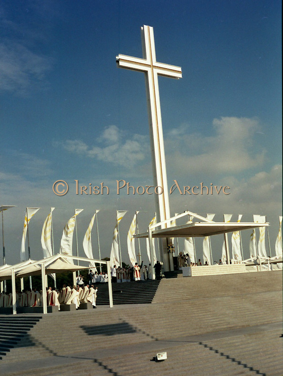 Pope John-Paul II visits Ireland..1979..29.09.1979..09.29.1979..29th September 1979..Today marked the historic arrival of Pope John-Paul II to Ireland. He is here on a three day visit to the country with a packed itinerary. He will celebrate mass today at a specially built altar in the Phoenix Park in Dublin. From Dublin he will travel to Drogheda by cavalcade. On the 30th he will host a youth rally in Galway and on the 1st Oct he will host a mass in Limerick prior to his departure from Shannon Airport to the U.S..A view of the altar totally dominated by the gigantic cross in the Phoenix Park.