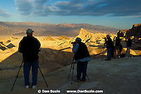 Photographers wait for sunrise at Zabriskie Point, Death Valley National Park, California