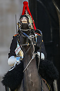 The Queen's cavalry horse whimpers as the soldier wearing a black fabric over his uniform observe the minute silence salute outside Horse Guards Parade in central London on Saturday, April 17, 2021, during the funeral of Prince Philip of the United Kingdom. The Queen announced the death of her beloved husband, His Royal Highness Prince Philip, Duke of Edinburgh who died at age 99. HRH passed away peacefully on April 9th at Windsor Castle after 73 years of marriage to Britain's Queen Elizabeth II. (Photo/ Vudi Xhymshiti)