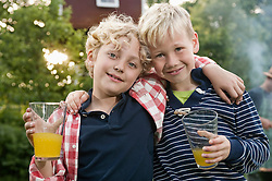 Portrait two young boys friends smiling blond