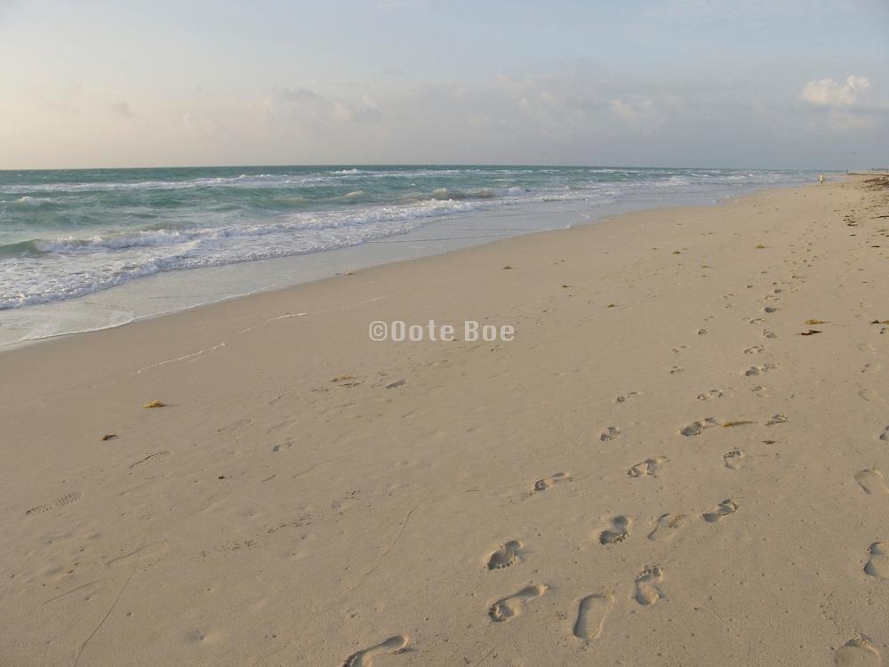 Foot prints along the beach early morning Miami Beach USA