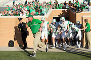 Marshall Thundering Herd head coach Doc Holliday takes the field before kickoff against the North Texas Mean Green at Apogee Stadium in Denton, Texas on October 8, 2016. (Cooper Neill for The Herald-Dispatch)