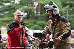 Doug Jones on his 1914 Indian Model F checks in with John Classen and Jim Feeney at the finish in Keane during the Motorcycle Cannonball coast to coast vintage run. Stage-1 (145-miles) from Portland, Maine to Keene, NH. Saturday September 8, 2018. Photography ©2018 Michael Lichter.