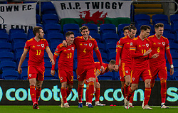 CARDIFF, WALES - Wednesday, November 18, 2020: Wales' Harry Wilson (2nd from L) celebrates after scoring the first goal with team-mate Chris Mepham during the UEFA Nations League Group Stage League B Group 4 match between Wales and Finland at the Cardiff City Stadium. Wales won 3-1 and finished top of Group 4, winning promotion to League A. (Pic by David Rawcliffe/Propaganda)