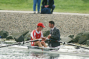 Hamilton, Scotland, Peter HAINING, {pinned to his Blazer the Wingfield Sculls and bars badge] wades out to congratulate, DEN LM1X  Karsten NIELSEN, after he wins the lightweight men's single sculls race at the FISA 1996 Junior and Non Olympic World Championships, Strathclyde Country Park, Rowing Course, Lanarkshire, 5/11.08.1996 [Mandatory Credit. Peter Spurrier/Intersport Images]