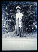 woman standing in garden outdoors setting France ca 1920s