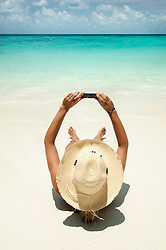 woman taking selfportrait on the beach, Koh Lipe, Thailand