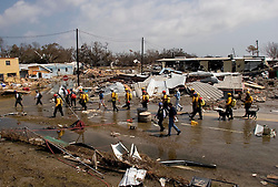 26th Sept, 2005. Cameron, Louisiana. Hurricane Rita aftermath. <br /> Members of the Las Vegas, Nevada Task Force 1, a FEMA search and rescue team scour the destroyed remains of houses and business in Cameron, Louisiana for any signs of life two days after the storm ravaged the small town.<br /> Photo; ©Charlie Varley/varleypix.com
