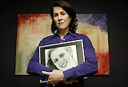 Twenty-four years ago, when Carolyn was just 14 years old, psychopath Ralph Ernest Power raped and killed her 20-year-old sister, Sheryl Gardner. Sheryl was living in Toronto pursuing a career as a fashion model at the time. Carolyn Gardner holds a photograph of her late sister Sheryl at her home on Wednesday,  Feb 21, 2007..Photo By Sean Kilpatrick.