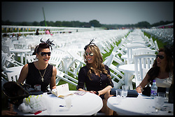 Racegoers enjoy drinks and picnics at Ascot races on Day 2 of Royal Ascot, <br /> Ascot, United Kingdom<br /> Wednesday, 19th June 2013<br /> Picture by Andrew Parsons / i-Images