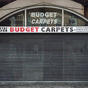 Budget Carpets. <br /> 19 Atlantic Road. <br /> <br /> Raymond Murphy opened his business 25 years ago. He employs 4 people in the shop plus 3 carpet fitters.