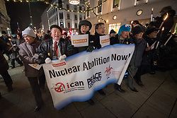 """10 December 2017, Oslo, Norway: In the evening of 10 December some 4,000 people from around the world gathered in central Oslo for a torch light march for peace. The event took place after the Nobel Peace Prize award 2017, awarded to the International Campaign to Abolish Nuclear Weapons (ICAN), for """"its work to draw attention to the catastrophic humanitarian consequences of any use of nuclear weapons and for its ground-breaking efforts to achieve a treaty-based prohibition of such weapons"""". Among the crowd were more than 20 """"Hibakusha"""", survivors of the atomic bombings in Hiroshima and Nagasaki, as well as a range of activists, faith-based organizations and others who work or support work for peace, in one or another way. Here, a group of Hibakusha."""